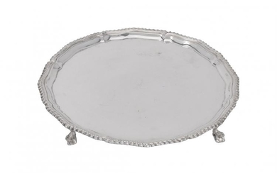 A silver shaped circular salver by Harrods Stores Ltd