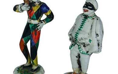 Two small statues Two male masks in multicoloured dresses in...