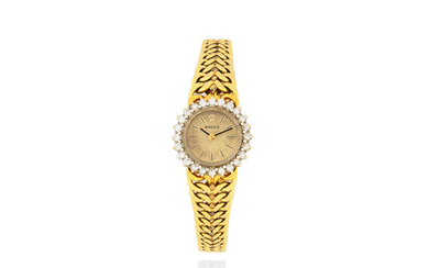 Rolex. A lady's 18K gold and diamond set manual wind bracelet watch