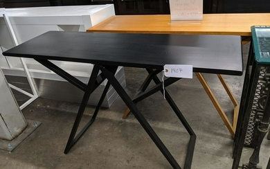 Pair of modern dark wood console tables.