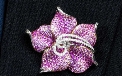 A diamond and pink sapphire flower brooch.May be worn