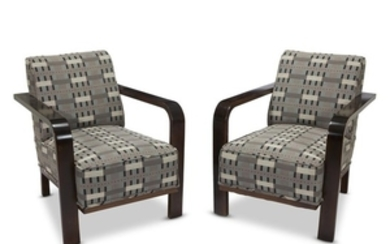 A pair of German Art Deco mahogany open armchairs...
