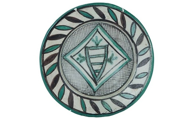 Plate Plate with convergent brim, carinated cavetto, disc-shaped base. Archaic...
