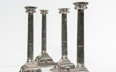 Two Pairs of George III Sterling Silver Candlesticks