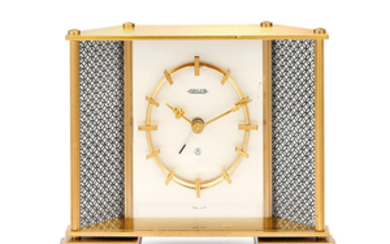 Jaeger-LeCoultre. A Gilt Brass Table Clock With 8-Days Power Reserve and Alarm