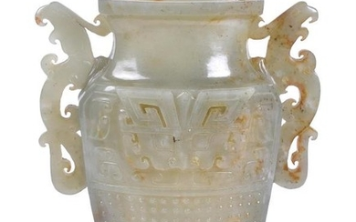 A Chinese celadon and russet jade archaistic vase