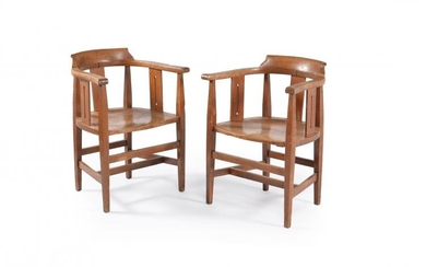 A pair of Arts and Crafts oak smokers bow armchairs