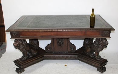 Italian library table with lion supports & leather top