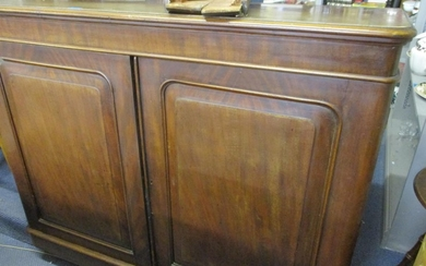 Circa 1880 a French walnut side cabinet with panelled doors,...