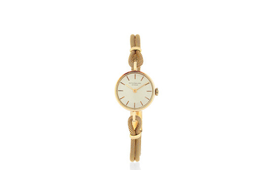 Patek Philippe. A lady's 18K gold manual wind bracelet watch