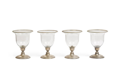 A set of four glass and silver plated hurricane lamps