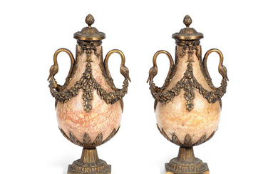 A pair of early 20th century French gilt bronze mounted garniture urns