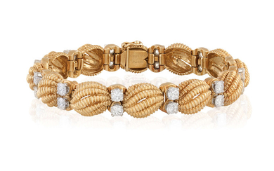 A GOLD AND DIAMOND BRACELET,...