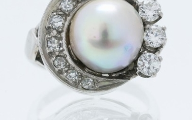 VINTAGE WHITE GOLD, DIAMOND AND CULTURED PEARL RING Formed as a crescent moon set with eight diamonds cradling a pearl and three bri...