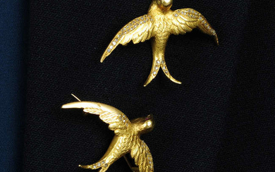 Two early 20th century 18ct gold swallow brooches, with rose-cut diamond and ruby accents.
