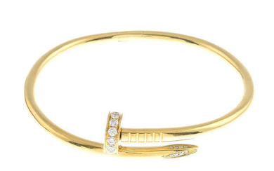 A diamond 'Juste un Clou' bangle, by Cartier. Estimated