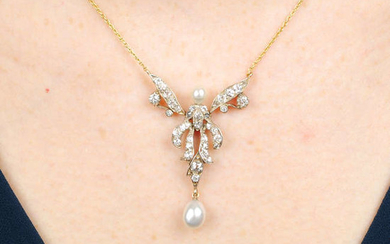 An old-cut diamond articulated floral pendant, with pearl highlights, on trace-link chain.