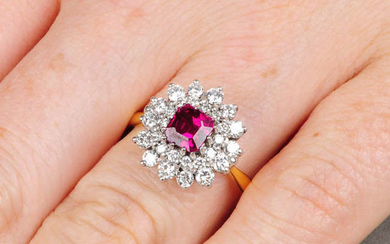 An 18ct gold ruby and brilliant-cut diamond cluster ring.
