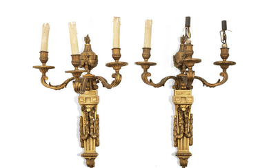 A pair of late 19th/early 20th century French gilt bronze three light wall appliques