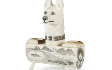 """Carved and incised """"dog head"""" walrus tusk ink well..."""