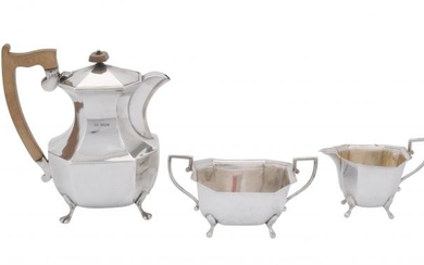 A silver canted rectangular hot water pot, cream jug and sugar basin by Viners