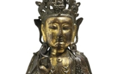 A PARCEL GILT-BRONZE FIGURE OF GUANYIN LATE MING