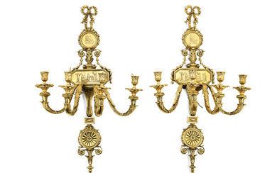 A pair of early 20th century four light polished bronze wall appliques