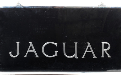 A Jaguar showroom sign,