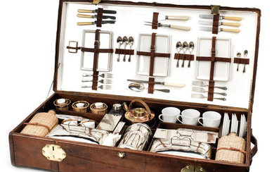 A large leather case fitted with picnic accessories by G W Scott & Sons for six-persons,