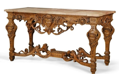 A Louis XIV style carved oak side table