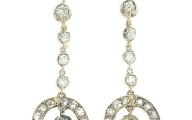 A pair of diamond drop earrings.Estimated total diamond