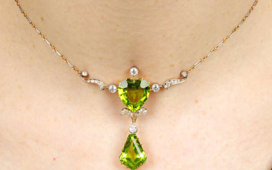 A late Victorian silver and gold, peridot and diamond pendant, on platinum and gold chain.