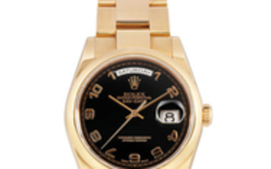Rolex. A Pink Gold Bracelet Watch with Day and Date