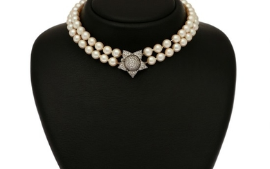 A two-strand pearl necklace set with numerous cultured pearls and a clasp set with numerous diamonds, mounted in 18k white gold. L. 36 cm.