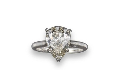 A diamond solitaire ring, the pear shaped diamond …