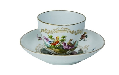 Cup and saucer Tea cup with flared handle and saucer....