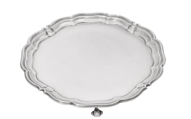 A silver shaped circular salver by Harrison Brothers & Howson