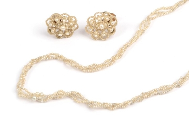 A Seed Pearl Necklace, three rows of entwined seed pearls,...