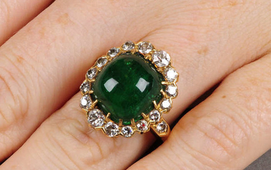 A Colombian emerald cabochon and circular-cut diamond cluster ring.