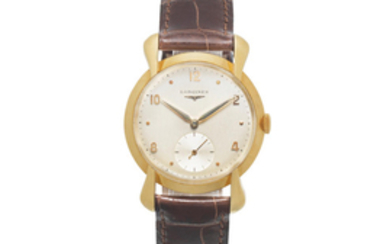 Longines. An 18K gold manual wind wristwatch with oversized lugs