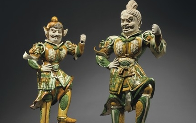 A PAIR OF MASSIVE SANCAI-GLAZED POTTERY GUARDIAN FIGURES, TANG DYNASTY (AD 618-907)