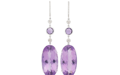 Amethysts and diamonds long earrings.