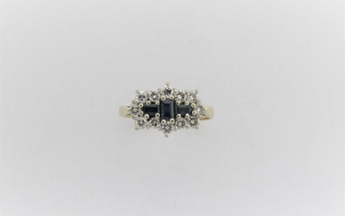 A ladies sapphire and diamond cluster ring, mounted with thr...