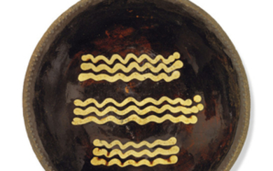 AN ENGLISH EARTHENWARE SLIPWARE BAKING OR LOAF-DISH, EARLY 19TH CENTURY, INCISED 24 TO THE REVERSE