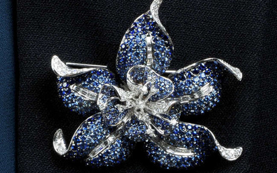 A sapphire and diamond flower brooch.May be worn as a