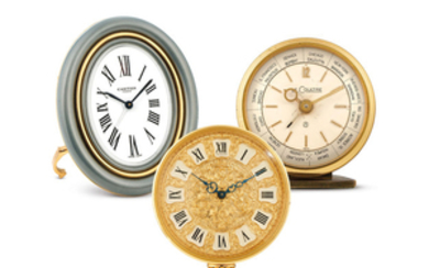 Cartier & LeCoultre. A group of three gilt brass table clocks (Alarm/Alarm Worldtime/Engraved dial)