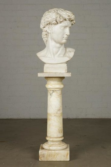An marble bust of a young man on pedestal