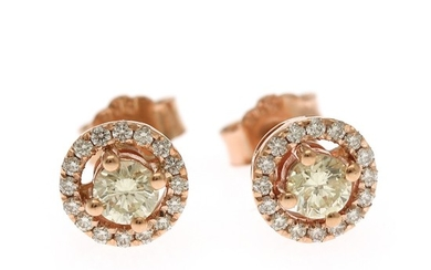 A pair of diamond ear studs each set with numerous brilliant-cut diamonds totalling app. 0.66 ct., mounted in 14k rose gold. (2)