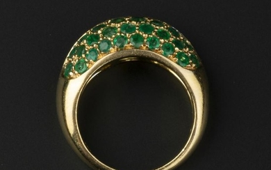 A diamond and emerald dress ring