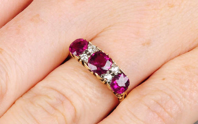 An early 20th century 18ct gold Thai ruby three-stone ring, with old-cut diamond accents.